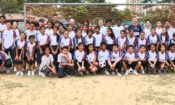 A group photo with coaches and students with U.S. Embassy Charge d'Affaires Edgard Kagan (back row, center, white shirt) (U.S. Embassy photo)